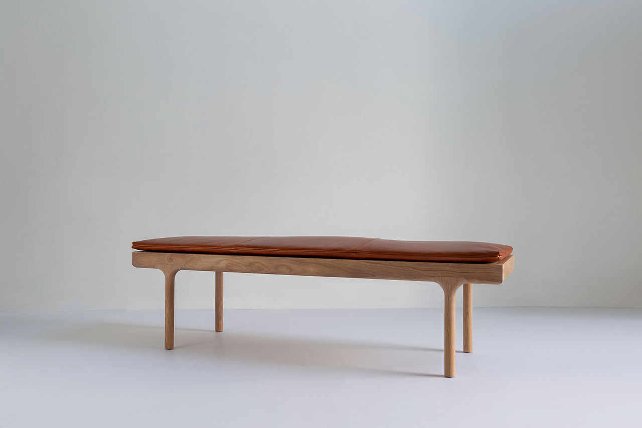 leather topped bench on light background