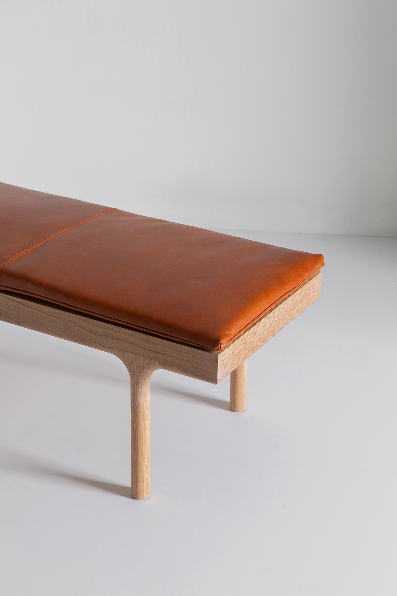 detail of leather topped bench on light background