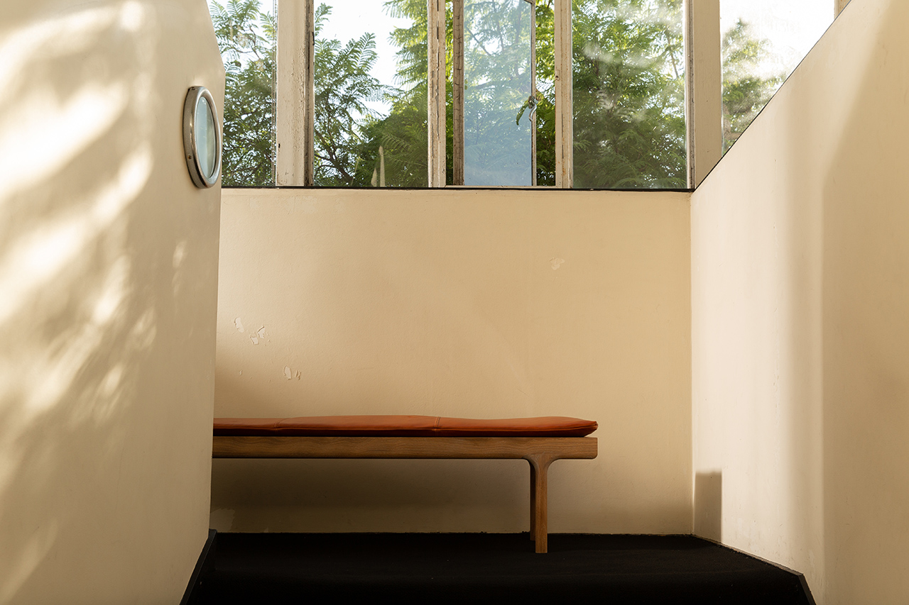 leather topped bench indoors with windows