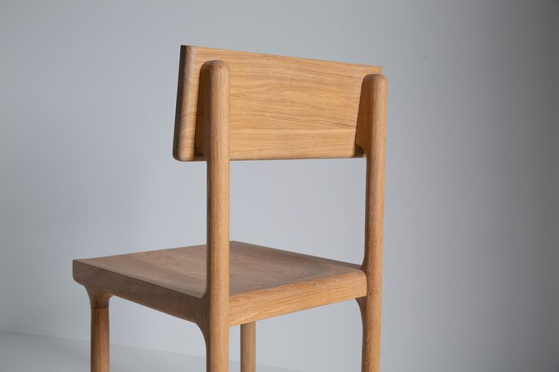 Oak dining chair on a white background