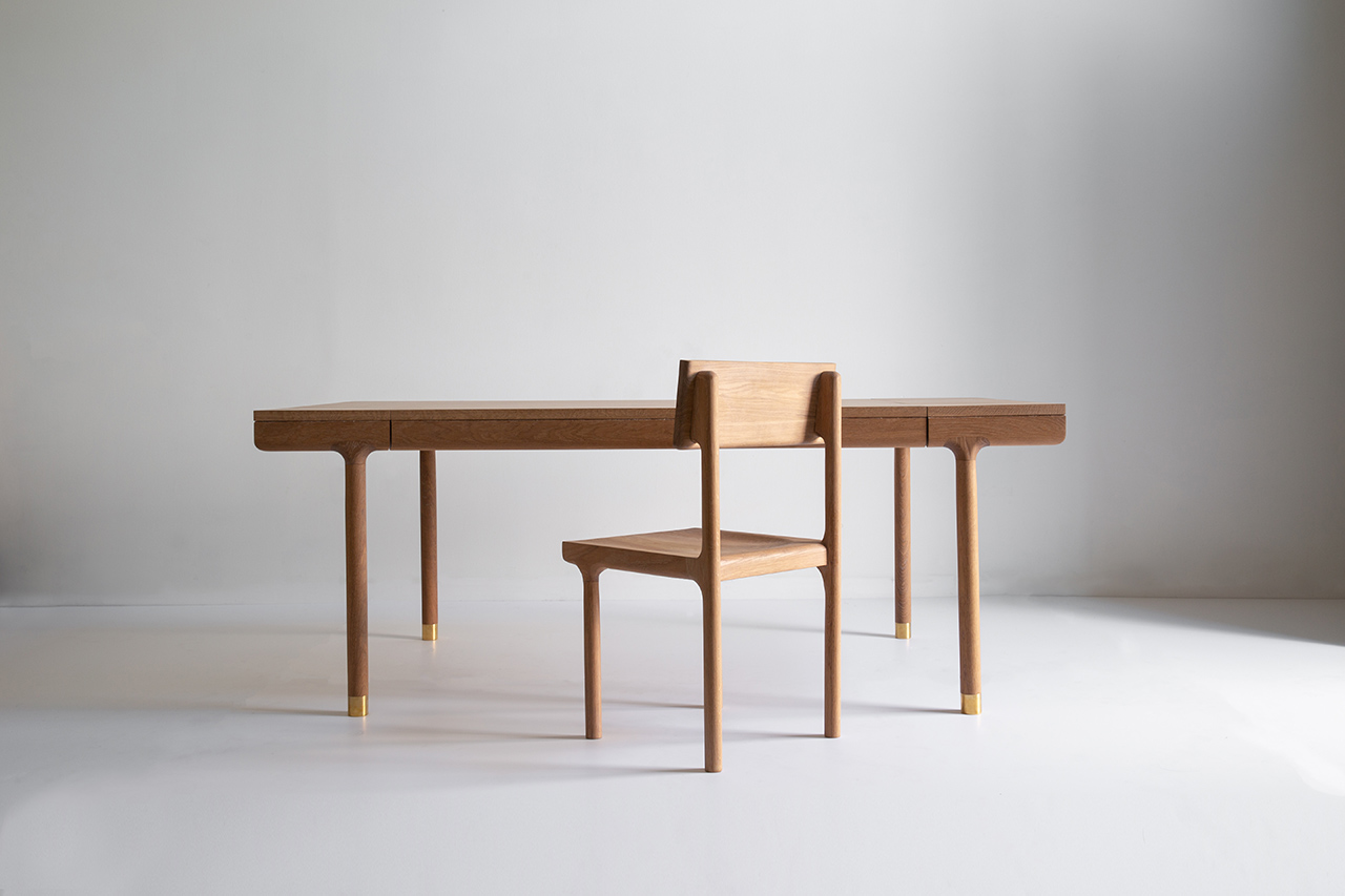 Oak dining chair and desk in light room