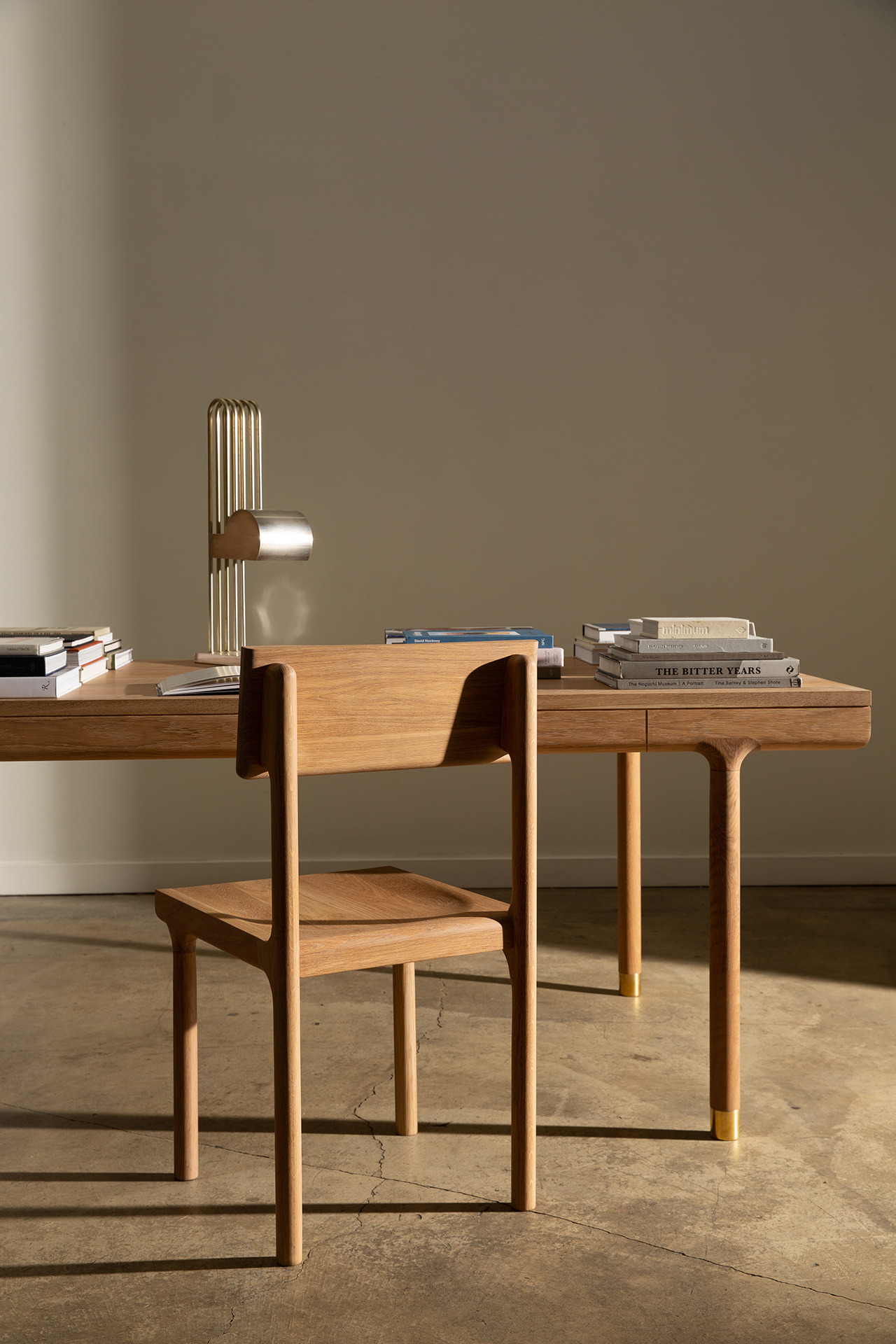 Oak dining chair and desk with accessories in light room