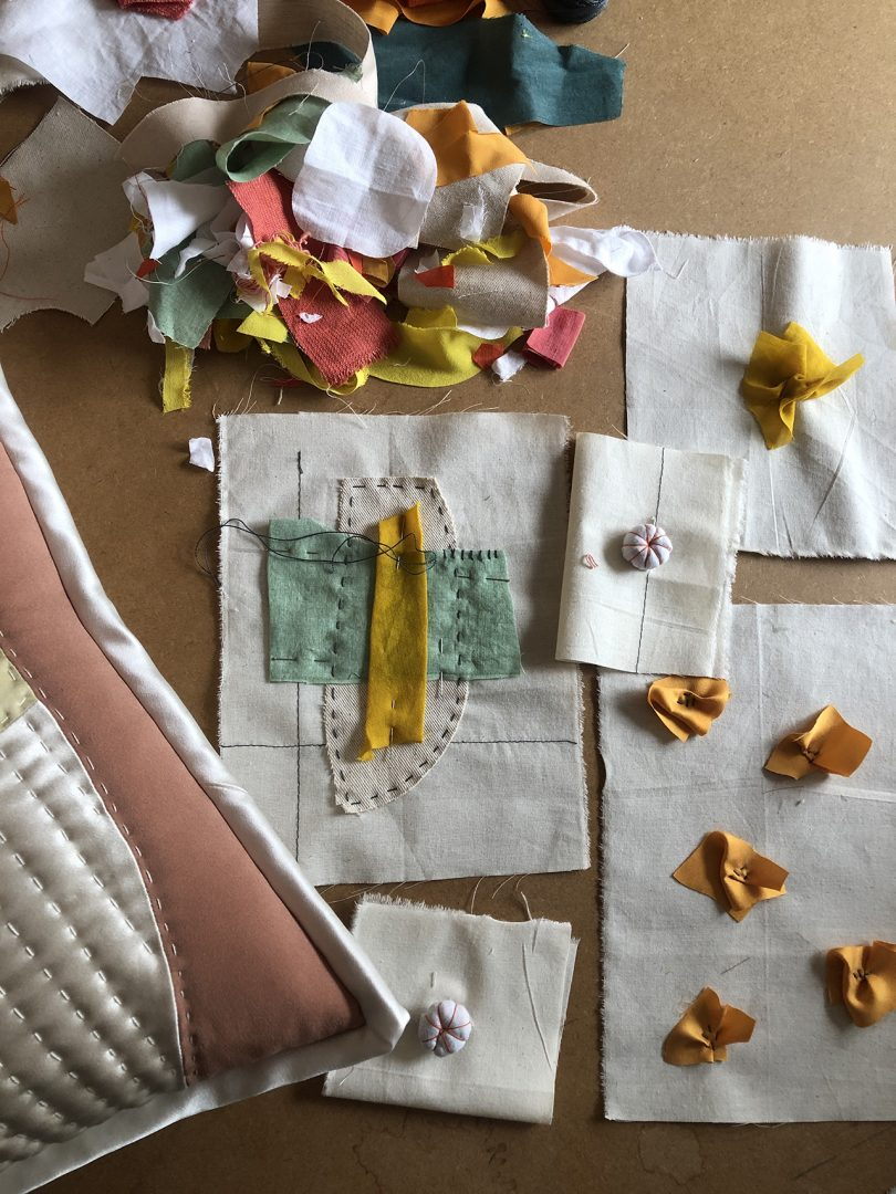 overhead photo of table with fabric scraps