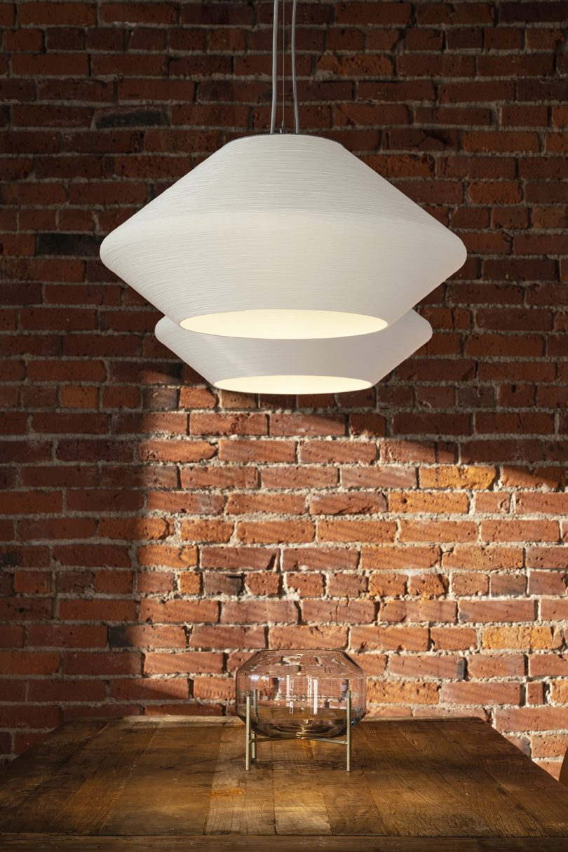 two hanging white pendant lights