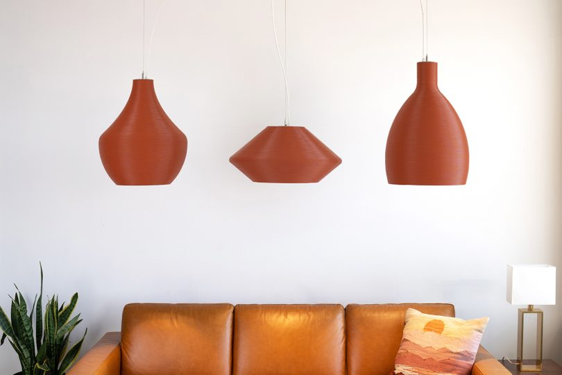 three red pendant lights in living space