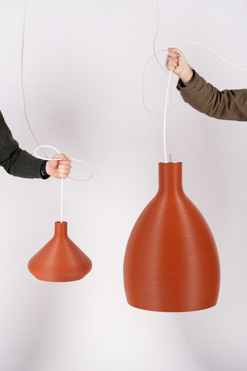 two red pendant lights being held