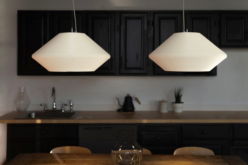 two white pendant lights in kitchen