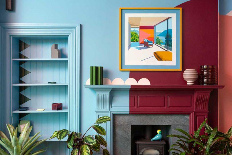 parede gráfica azul e bordô com lareira