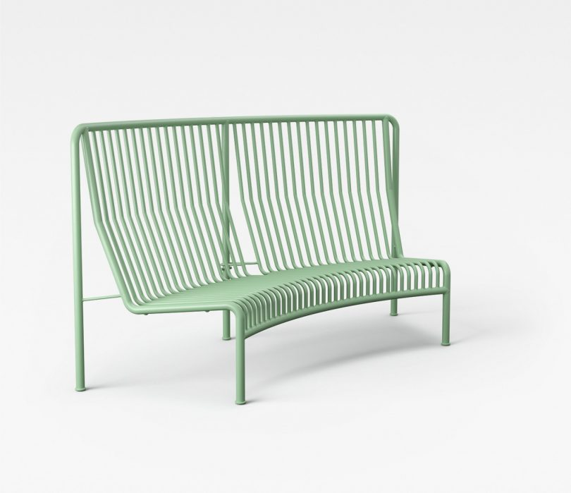 green wire bench on white background