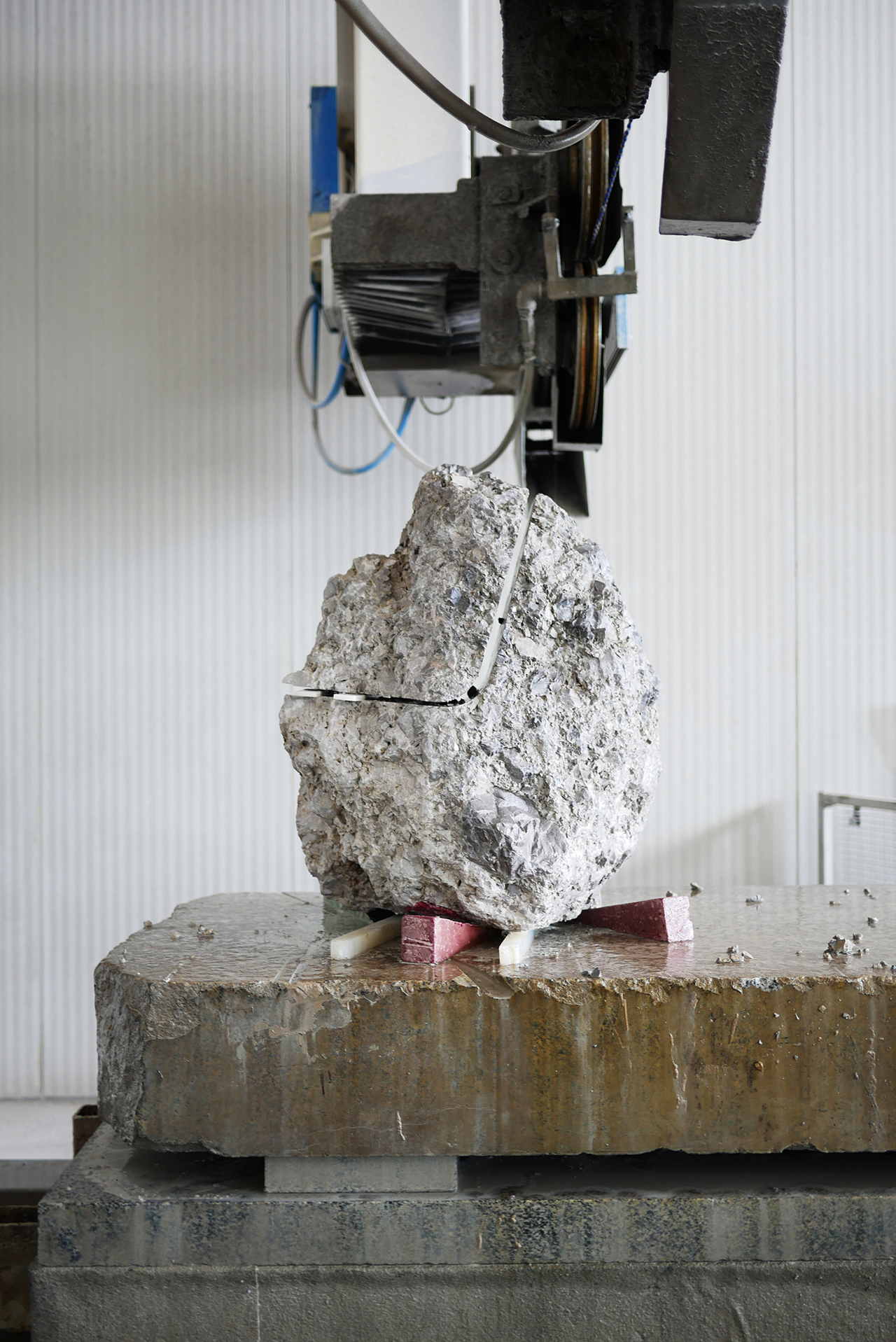 grey stone chair being made