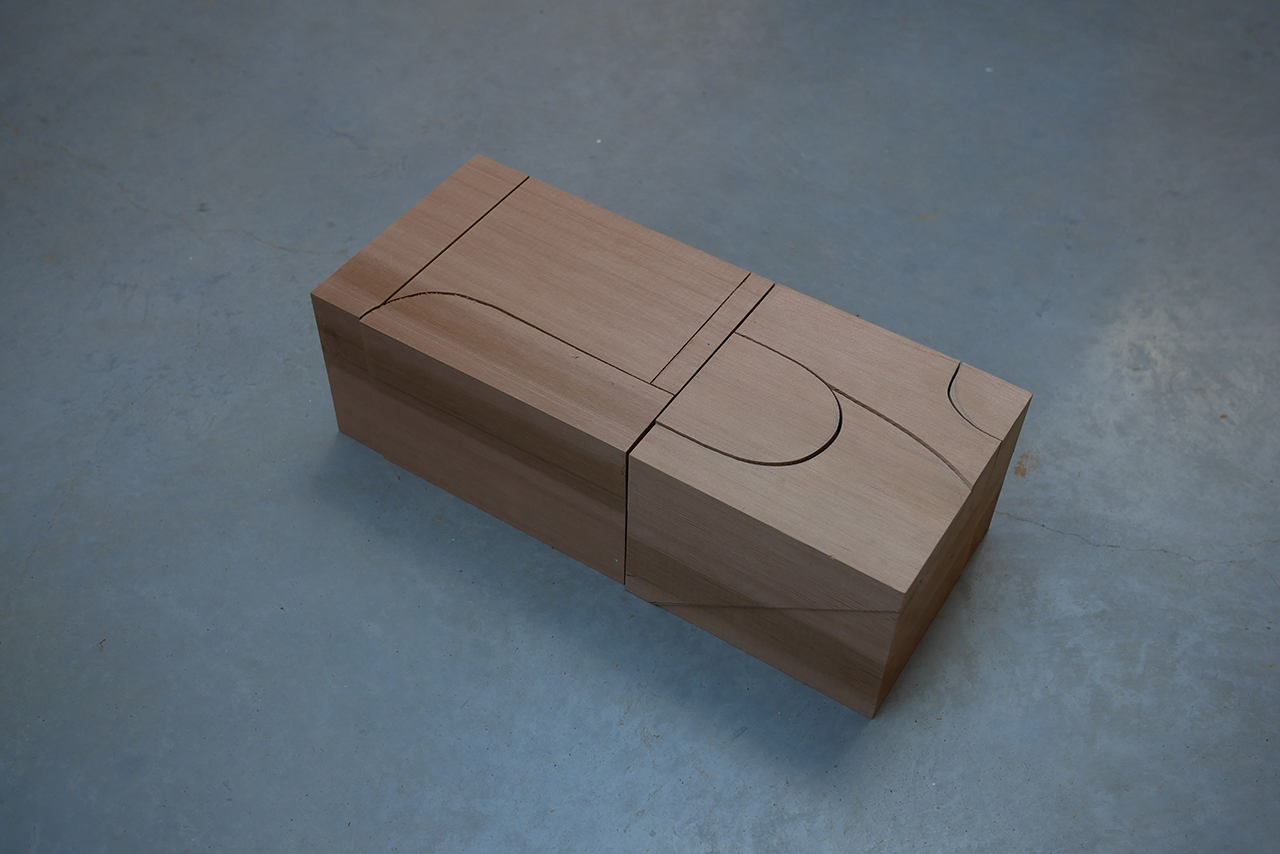 asymmetrical red cedar chair design being planned