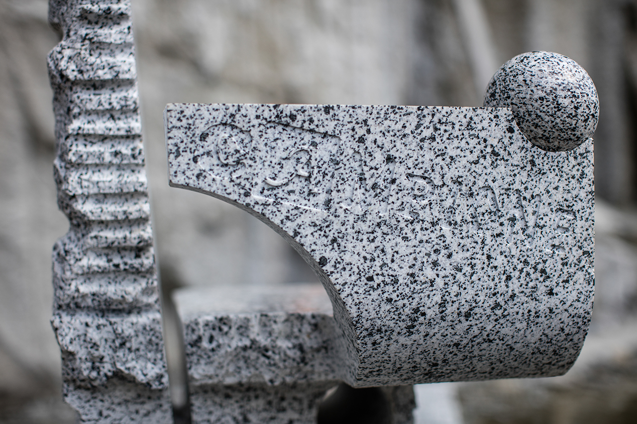 detail of chair made of grey stone