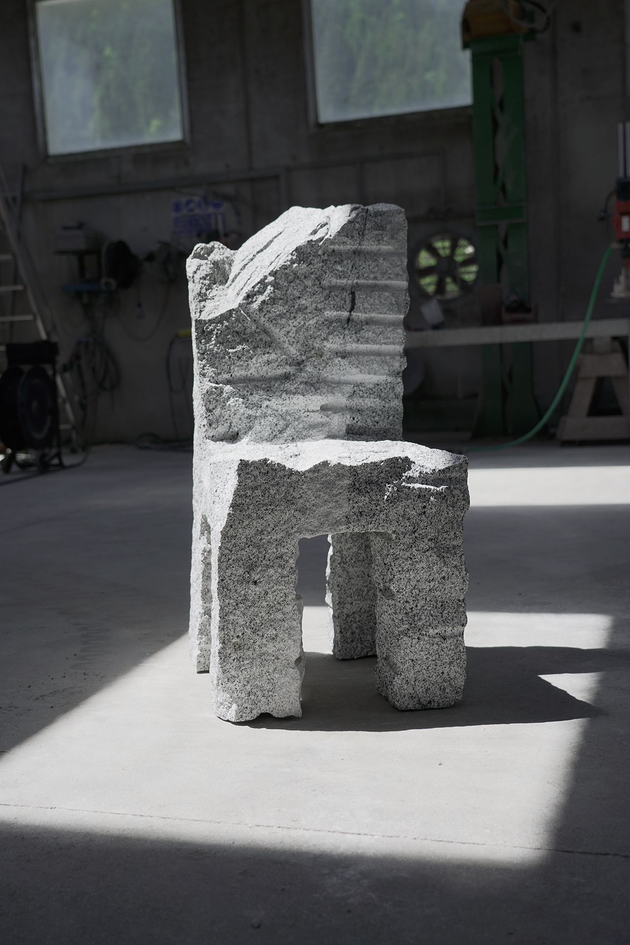 chair made of grey stone