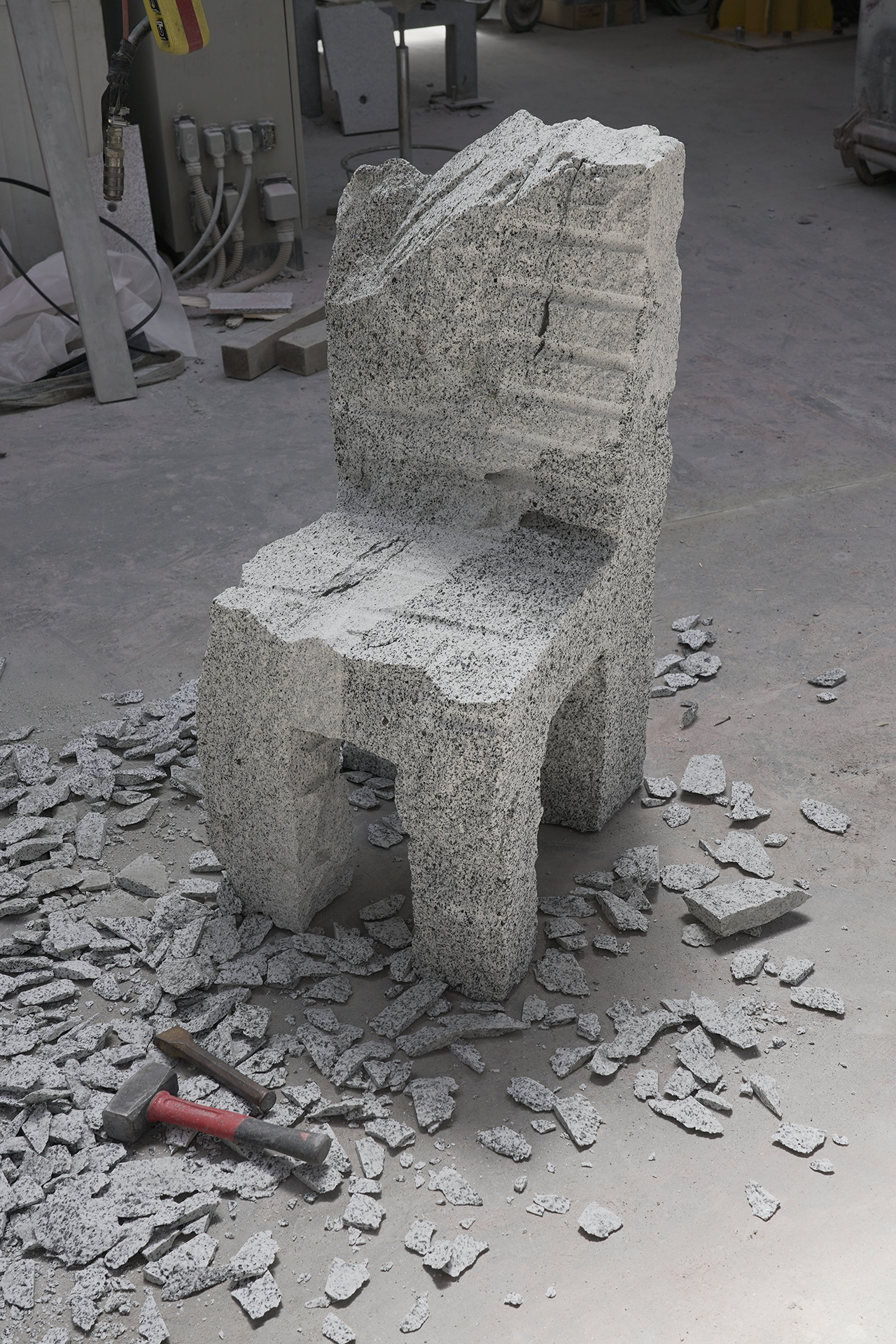 chiseled chair made of grey stone