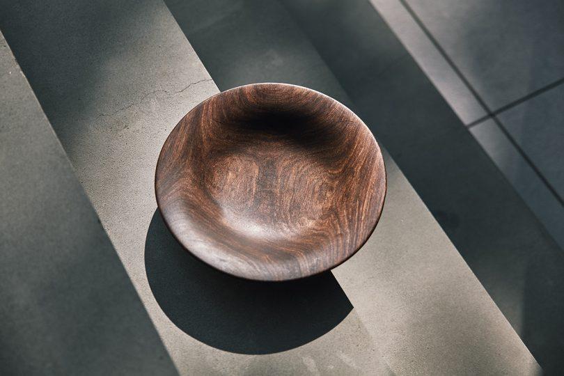 wooden bowl sitting on ledge