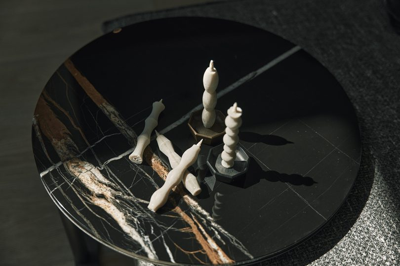 five candles on marble tabletop