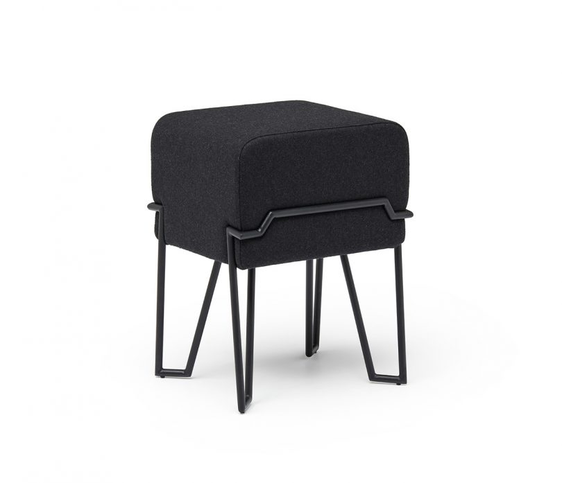 short black stool with metal legs on white background