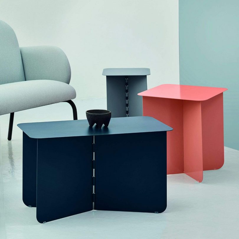 the folding tables of various sizes and an armchair on light background