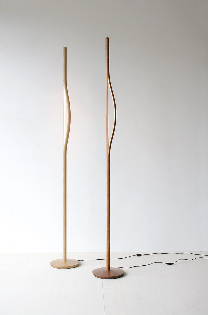 two wood floor lamps