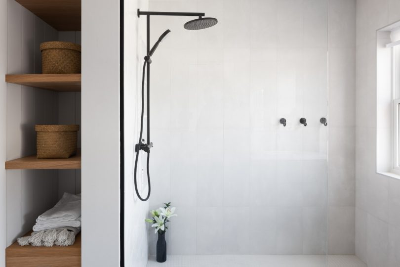 modern bathroom with rainfall shower and open shelving