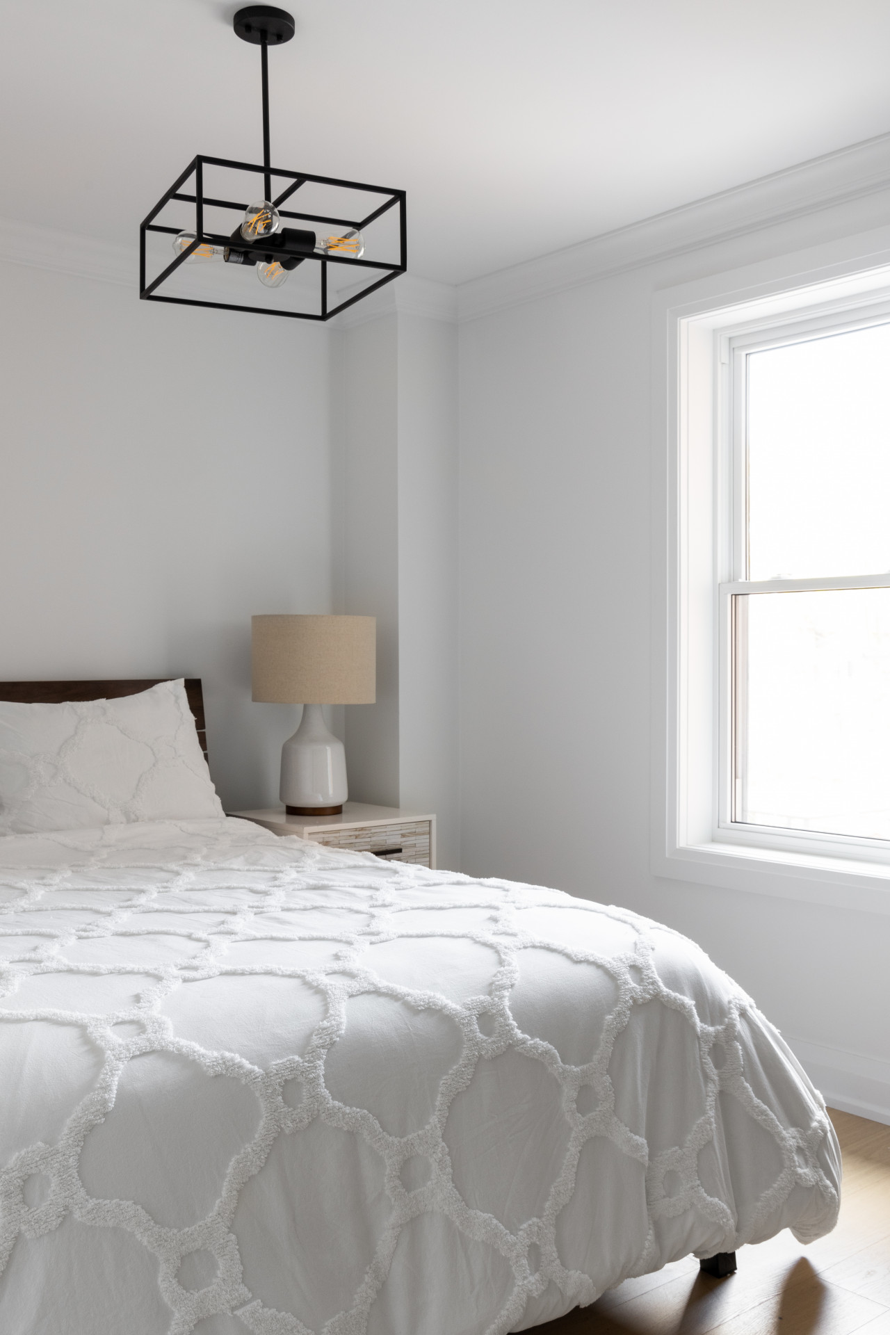 bedroom with modern pendant