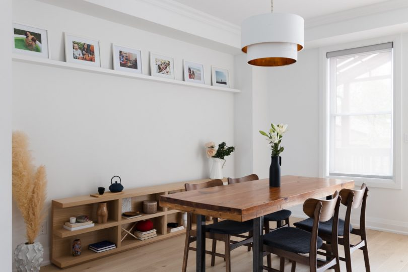 dining room with picture ledge