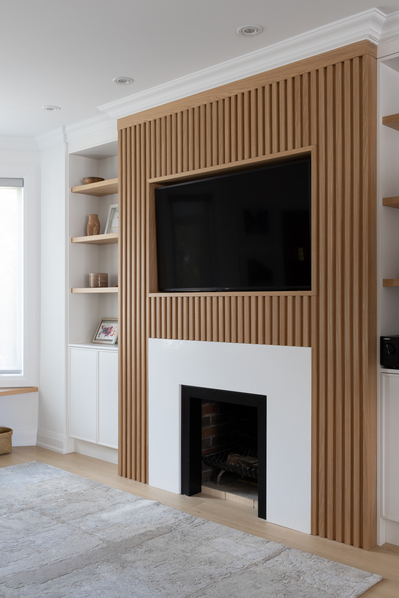 slatted wall with fireplace and built-ins