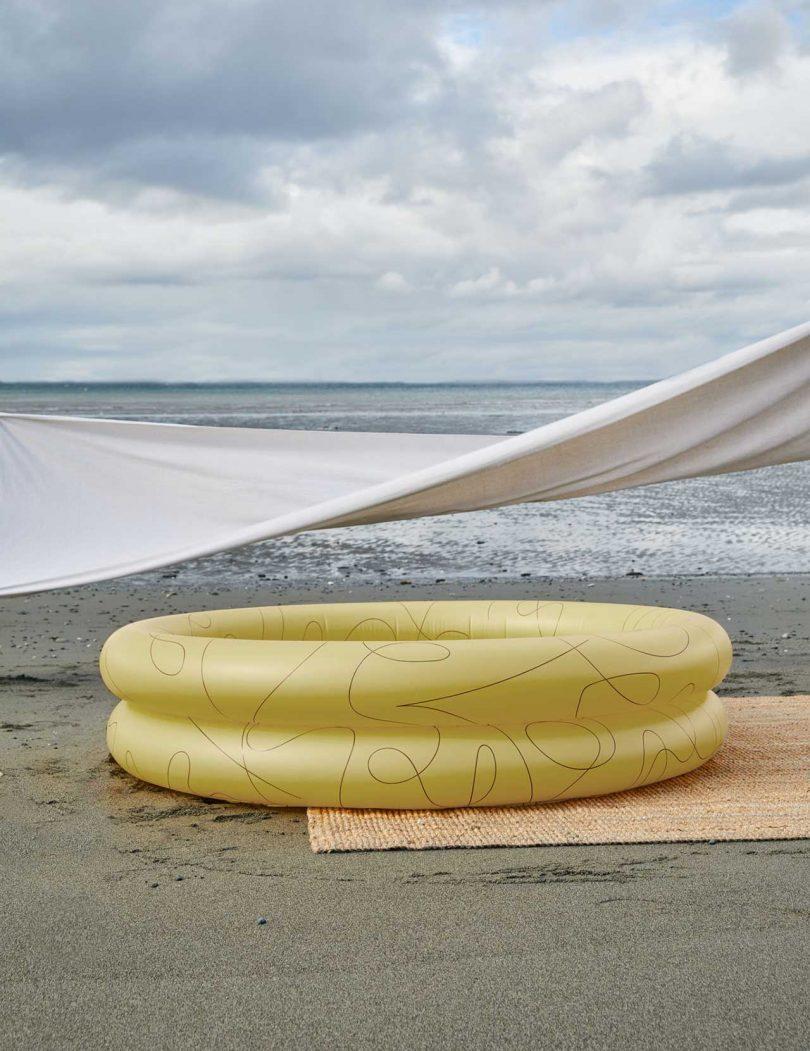 yellow inflatable pool on beach