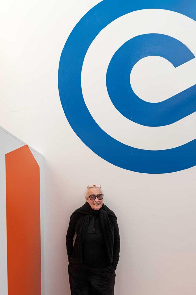 artist Barbara Stauffacher Solomon in front of graphic