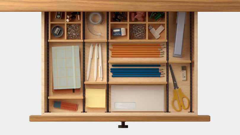 overhead photo of adjustable drawer organizer with desk accessories