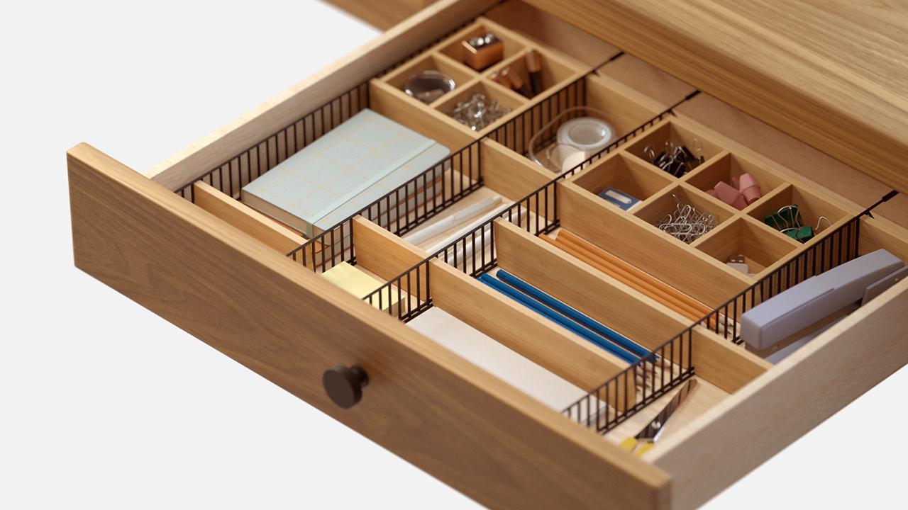 adjustable drawer organizer with desk accessories on white background