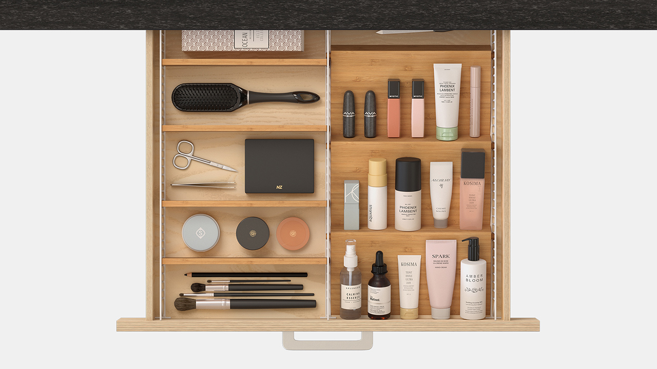 overhead photo of adjustable drawer organizer with makeup