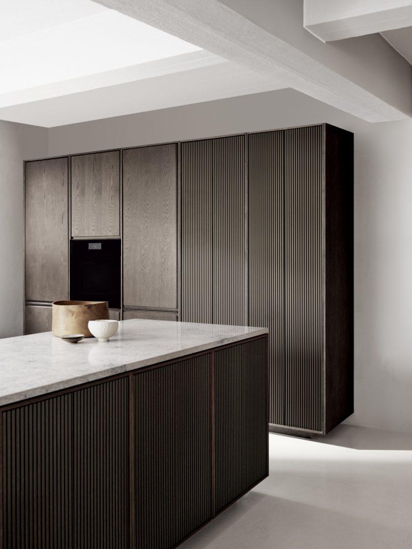 Vipp V2 stone and oak kitchen