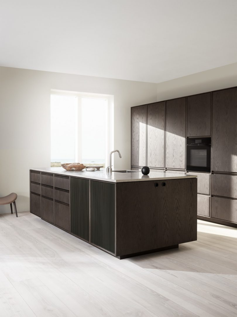 Vipp stone and oak kitchen