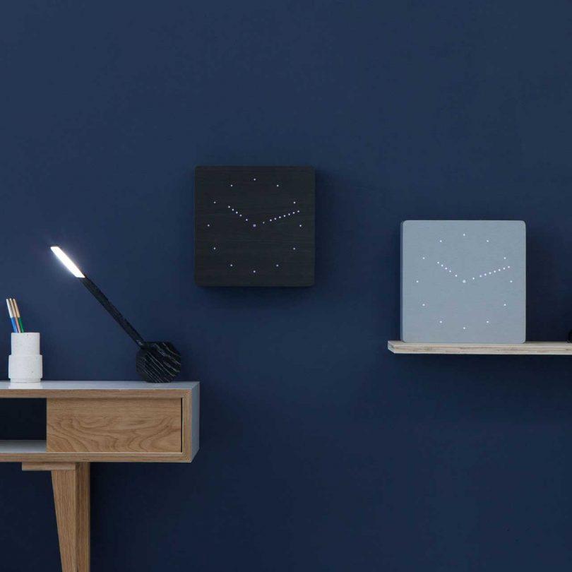 digital clocks on blue wall
