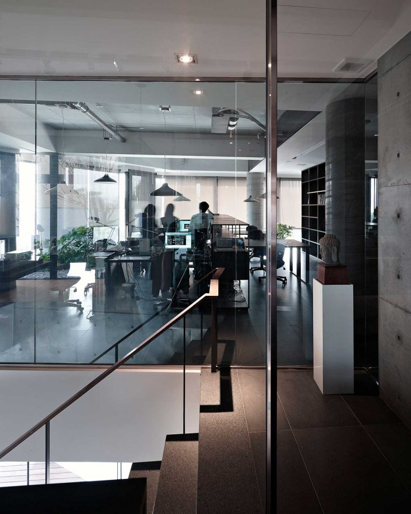 looking through glass into a corner office