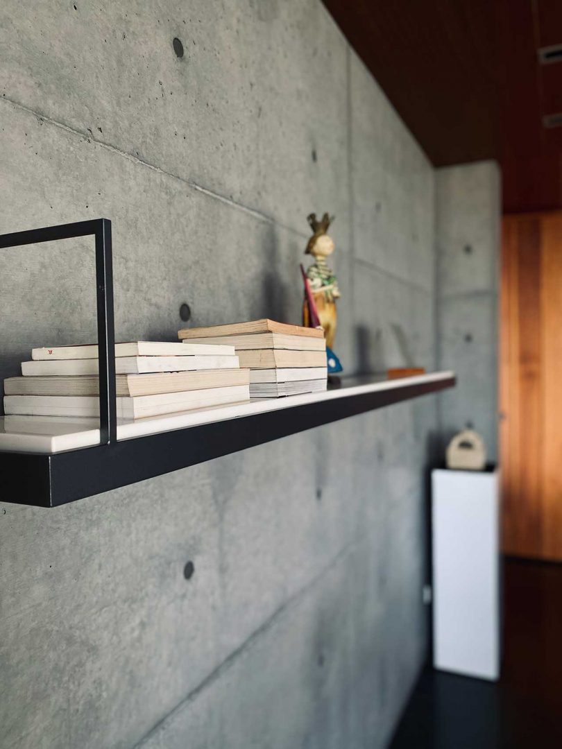 closeup of wall shelf on concrete wall