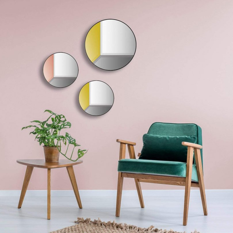 three multicolor round wall mirrors in living space