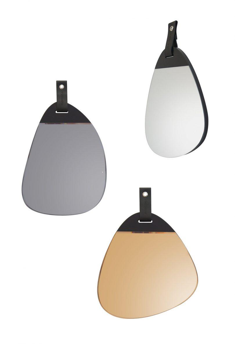 three organic shaped wall mirrors