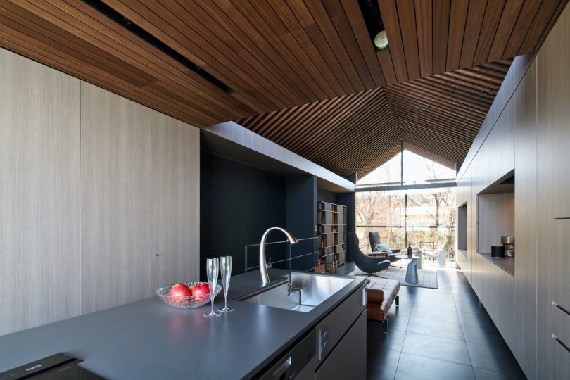 modern kitchen with views to the living room and outdoors