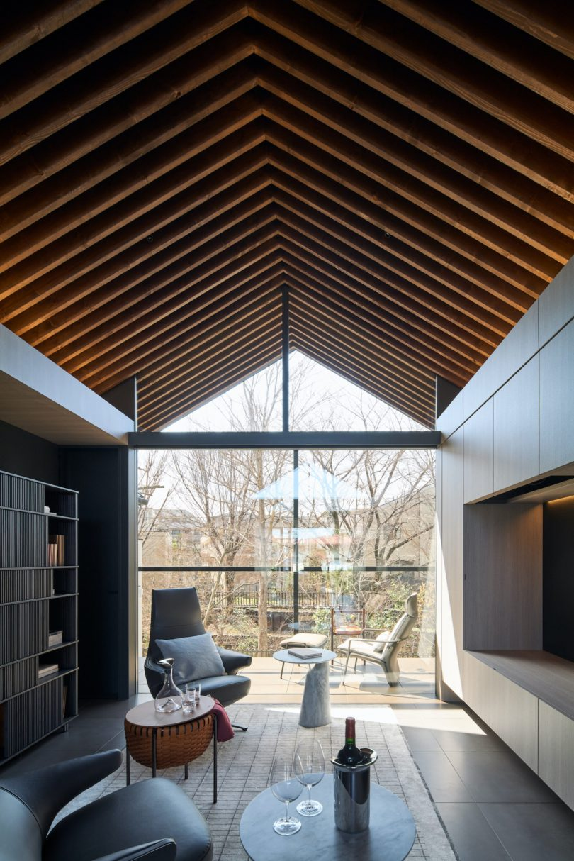 modern living room with pitched ceiling and views outdoors