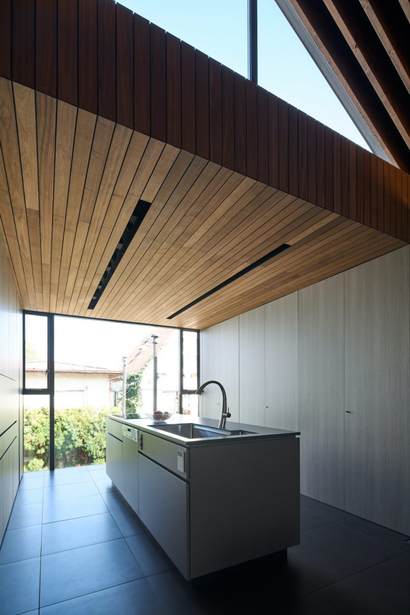 modern kitchen with center island and wood ceiling