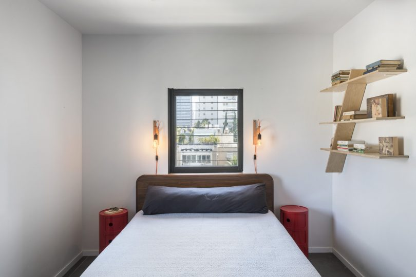 main bedroom with wall shelf