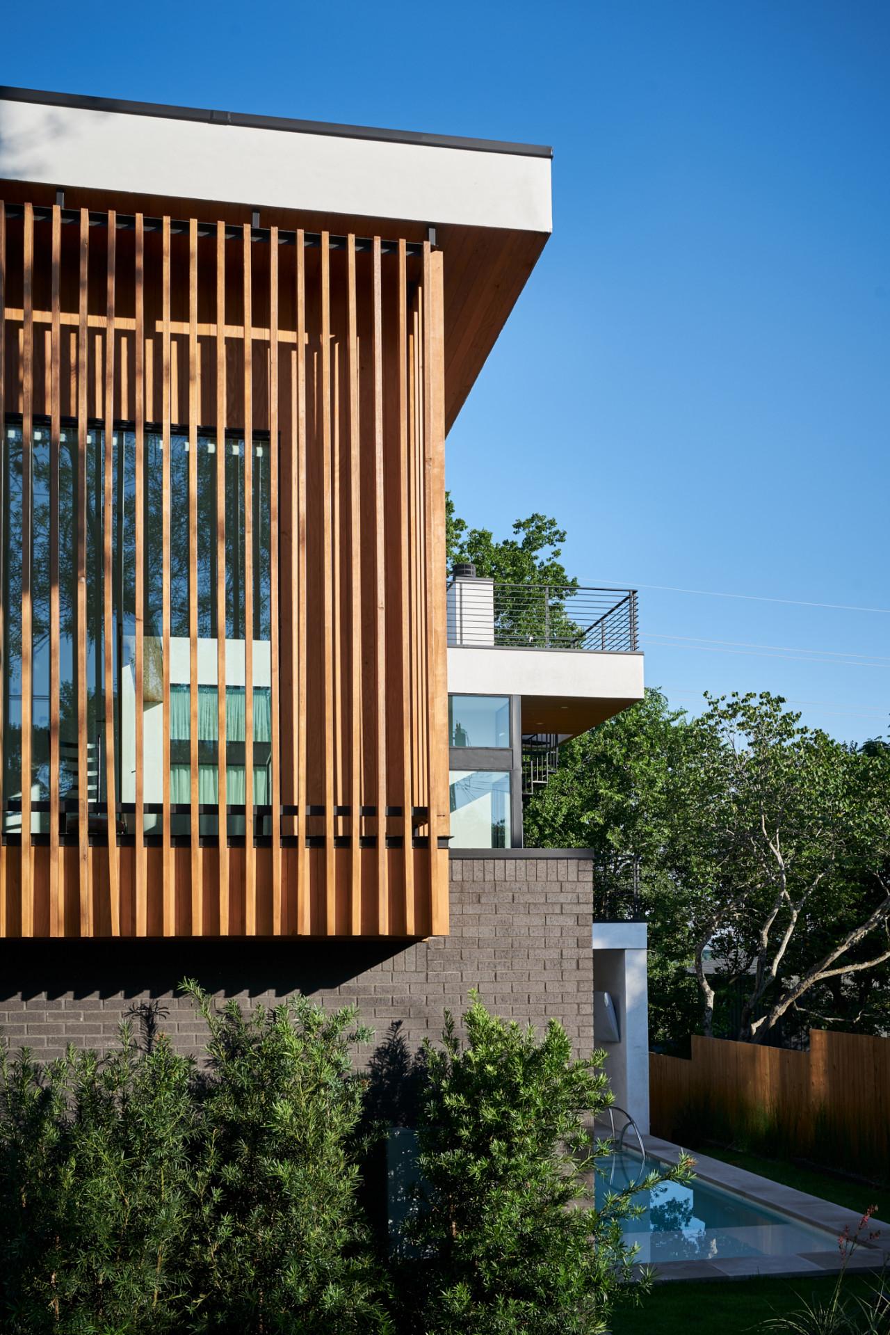 Glass house with wood slats