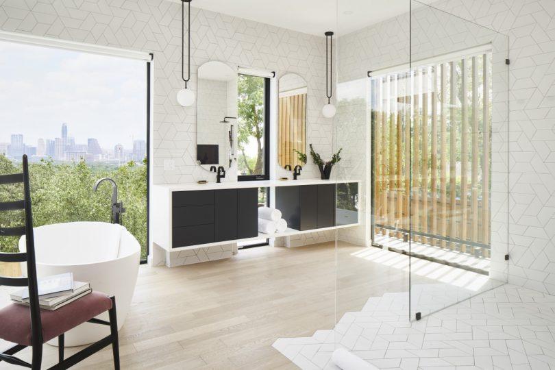 bathtub in bathroom with downtown Austin views