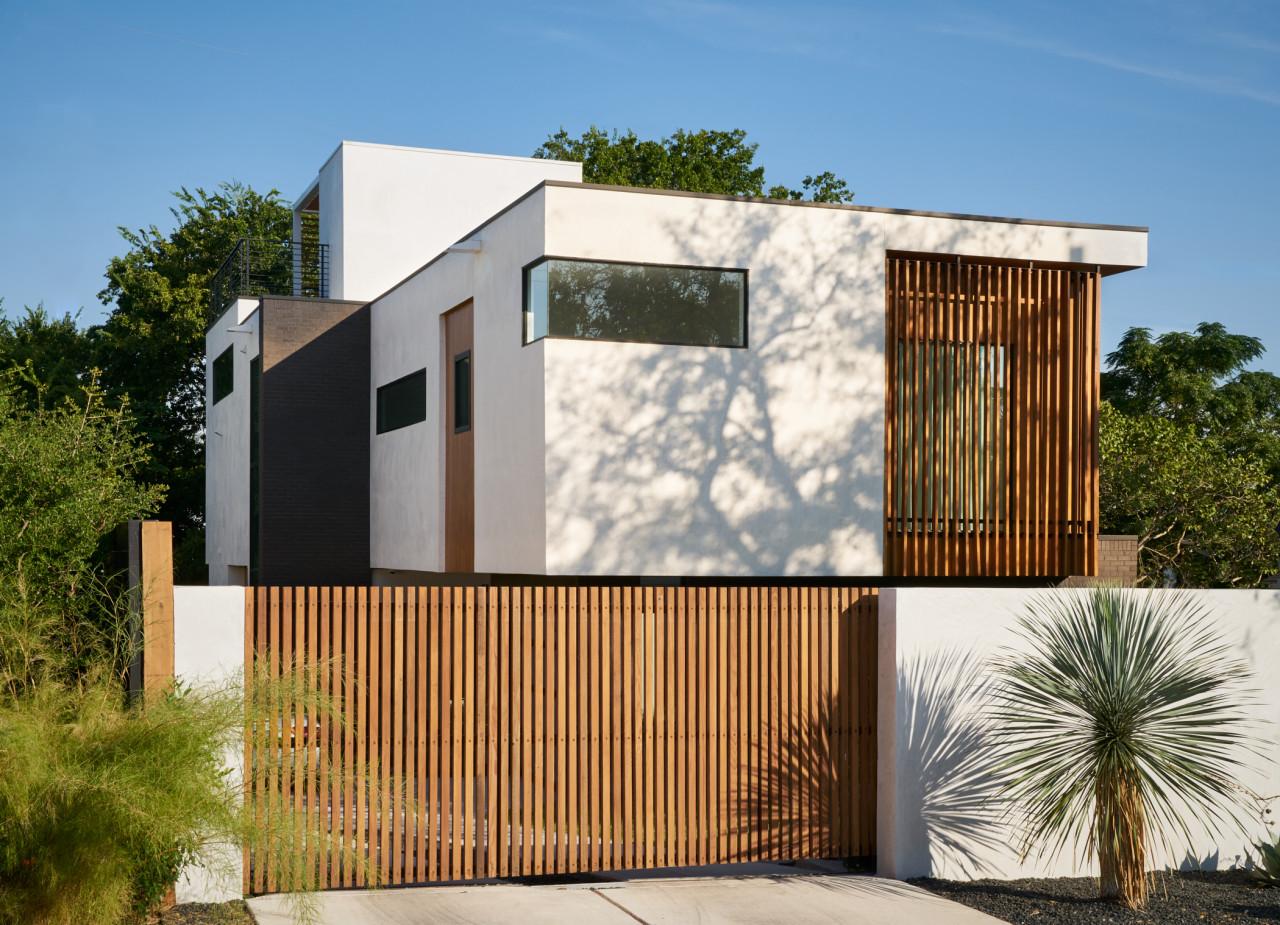 Glass house with wood slat gate