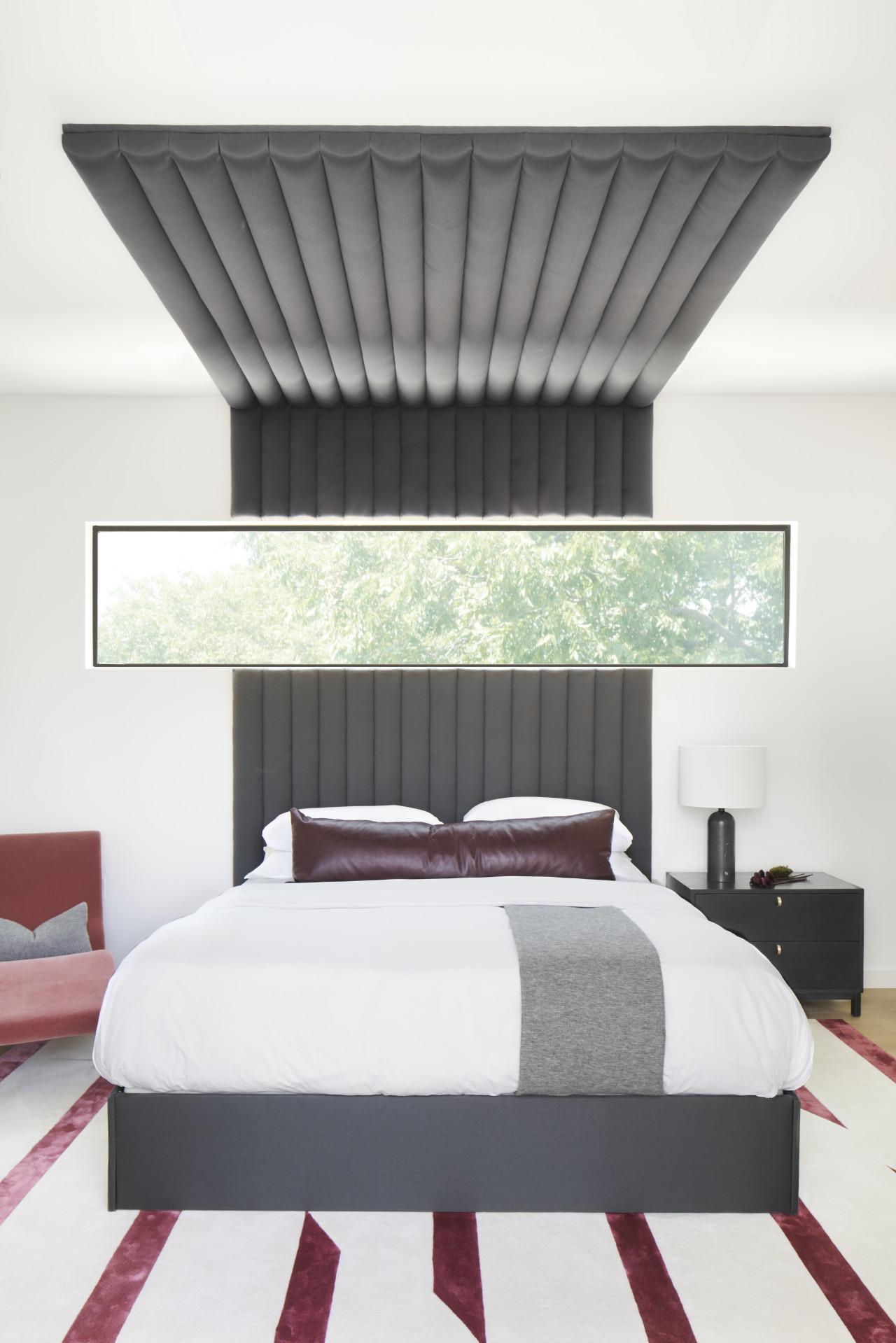 modern bedroom with stripe rug