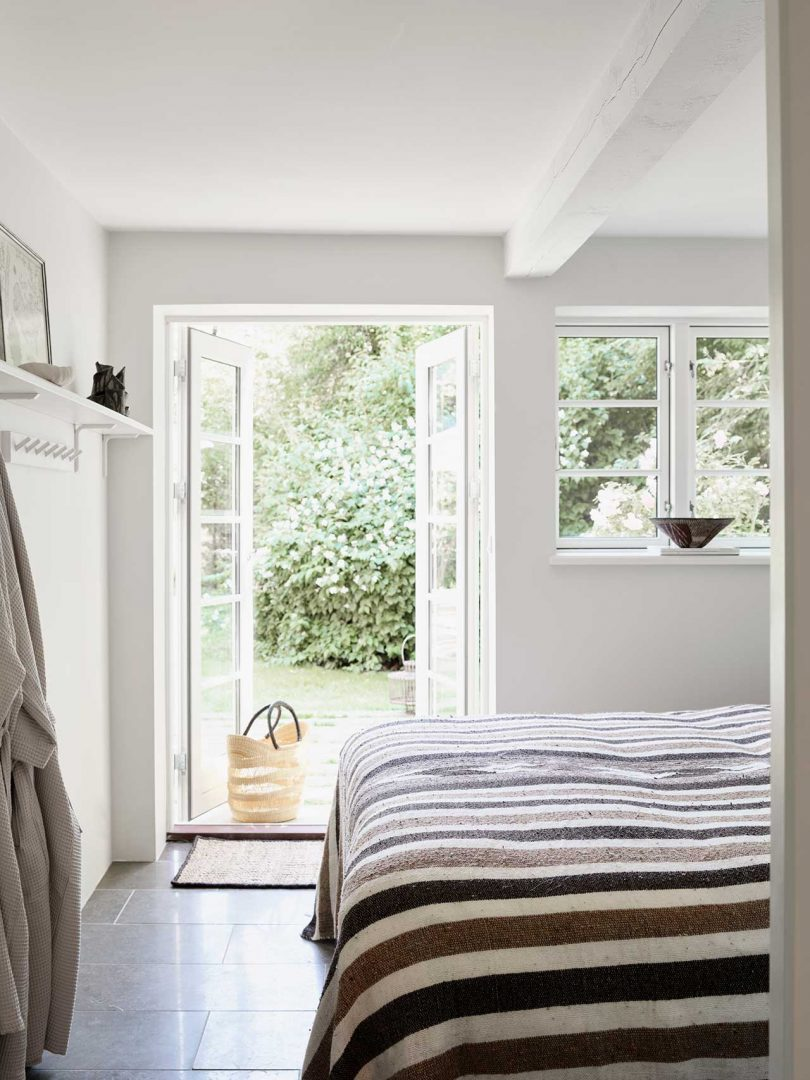bedroom with striped bedding