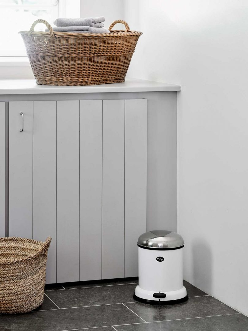 cabinet with Vipp trash can