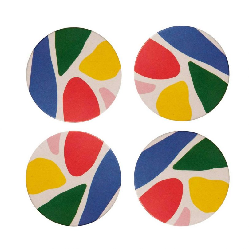 bamboo coasters with a colorful abstract pattern